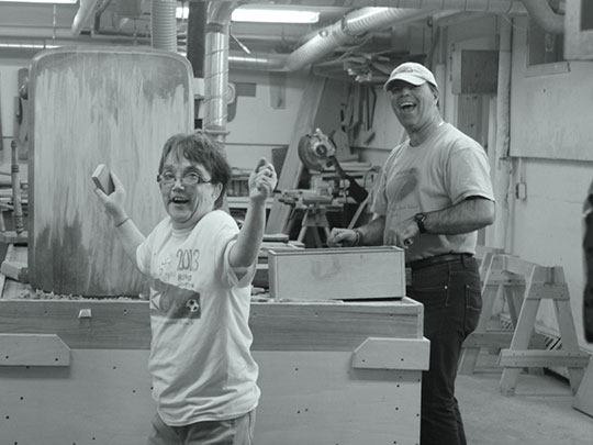 Enthusiastic woodshop workers
